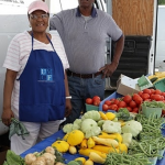 Hospital volunteer Ms. Langley and one of the farmers at United Medical Center's farmers market.